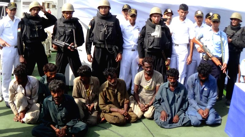Porbandar : Pakistani nationals arrested by Navy and Coast Guard with drugs near Porbandar coast on April 21, 2015.