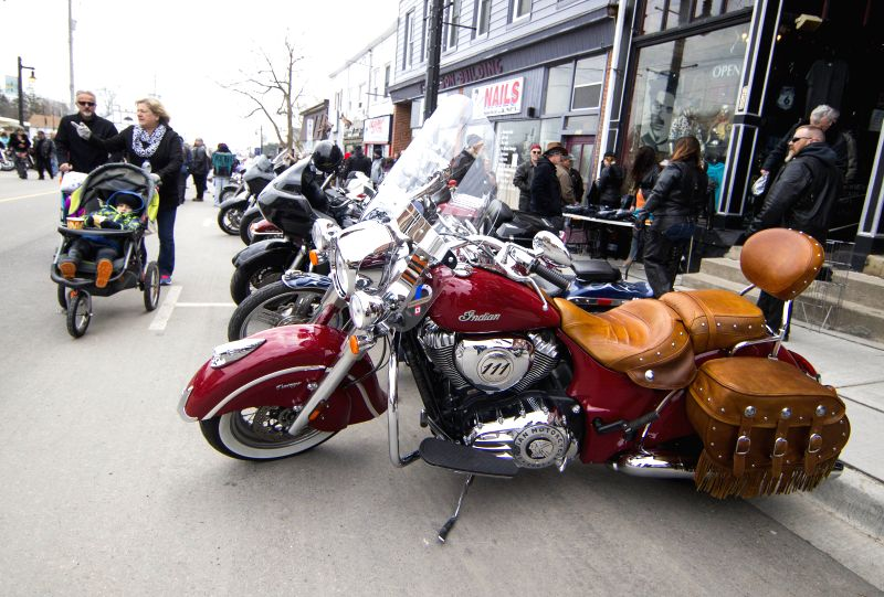 PORT DOVER, April 14, 2018 - People gather for the Friday the 13th Motorcycle Rally in Port Dover, Ontario, Canada, on April 13, 2018. The traditional event is held every Friday the 13th in the small ...