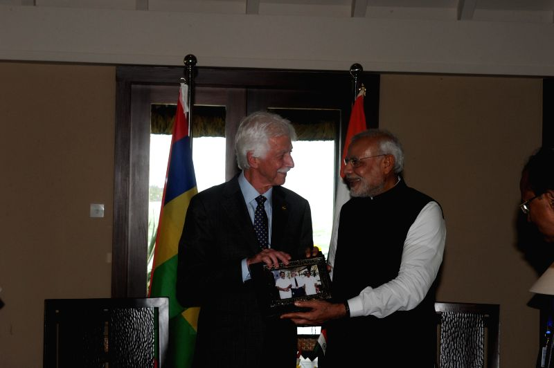 Port Louis: Narendra Modi meets Paul Berenger, the leader of opposition of Mauritius in Port Louis on March 12, 2015. - Narendra Modi