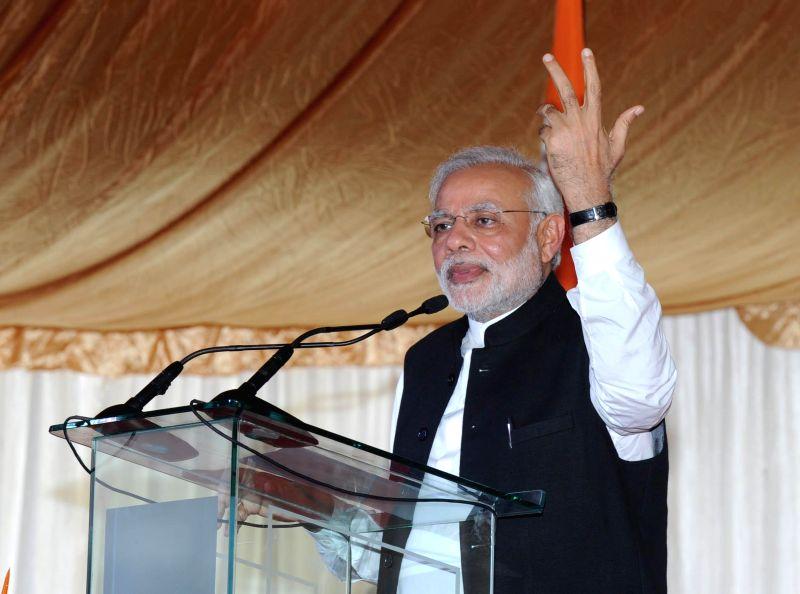 Port Louis: Prime Minister Narendra Modi addresses at the civic reception hosted in his honour at Mahatma Gandhi Institute in Port Louis, Mauritius on March 12, 2015. - Narendra Modi