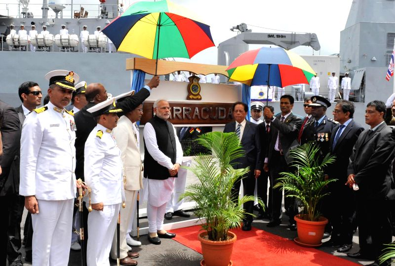 Port Louis: Prime Minister Narendra Modi at the Joint Commissioning of Offshore Patrol Vessel (OPV) Barracuda, at the Port Louis Harbour, in Mauritius on March 12, 2015. Also seen the Prime Minister ... - Narendra Modi