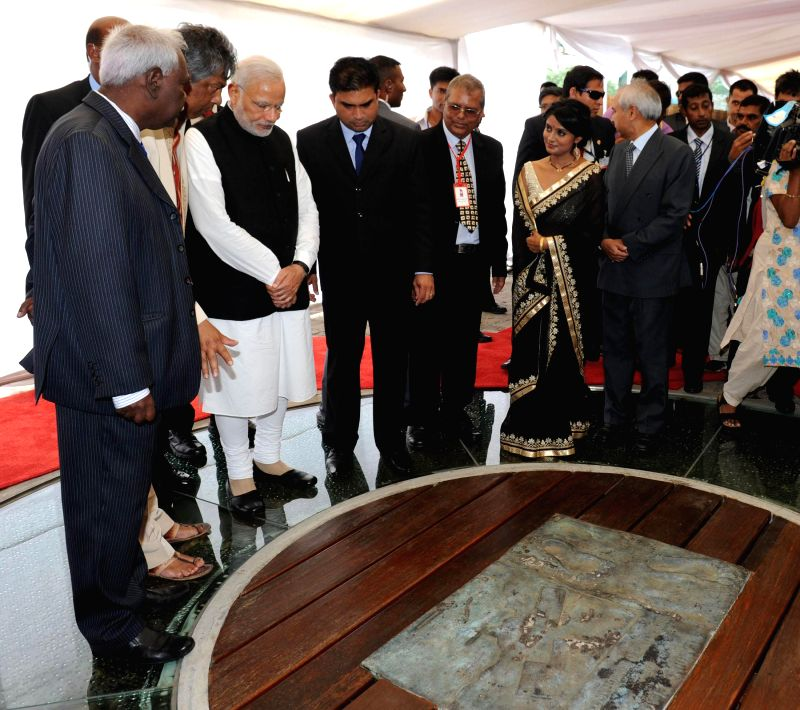 Port Louis: Prime Minister Narendra Modi during his visit to the Aapravasi Ghat, in Port Louis, Mauritius on March 12, 2015. - Narendra Modi