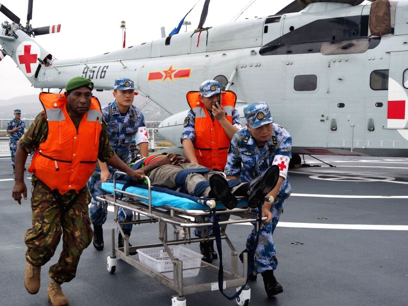 "PORT MORESBY, July 18, 2018 - The medical staff of Chinese naval hospital ship Ark Peace and their counterpart of Papua New Guinea transfer an ""injured"" person during a joint emergency ..."