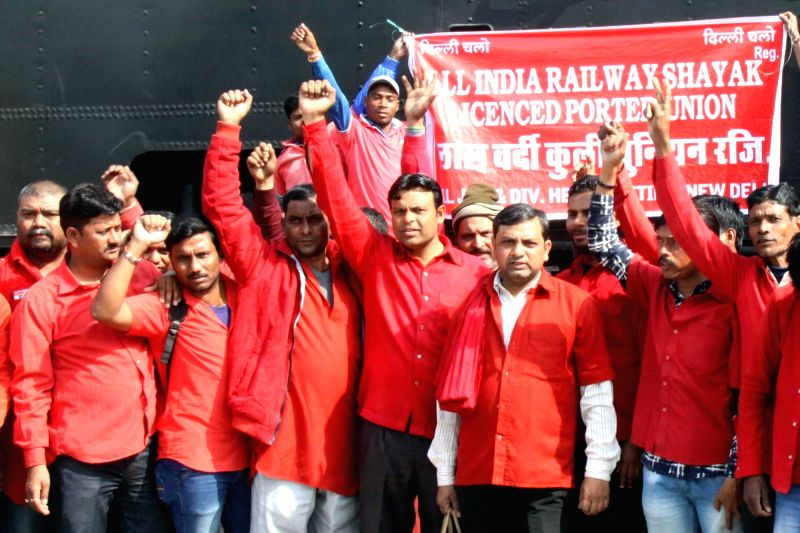 Porters stage a demonstration against Union Budget 2018-19 at New Delhi railway station on Feb 1, 2018.