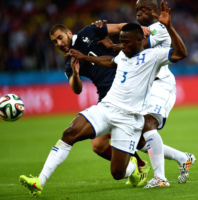 Frances's Karim Benzema vies with Honduras's Maynor Figueroa during a Group E match between France and Honduras of 2014 FIFA World Cup at the Estadio Beira-Rio