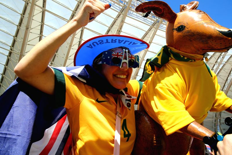 An Australia's fan cheers before a Group B match between Australia and Netherlands of 2014 FIFA World Cup at the Estadio Beira-Rio Stadium in Porto Alegre, ...