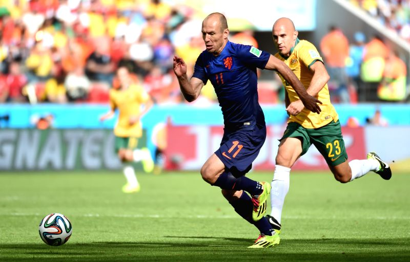Netherlands' Arjen Robben (front) runs with the ball during a Group B match between Australia and Netherlands of 2014 FIFA World Cup at the Estadio Beira-Rio ..