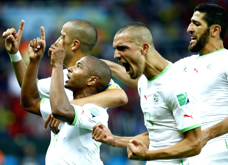 Algeria's Yasine Brahimi (1st L) celebrates the goal during a Group H match between Korea Republic and Algeria of 2014 FIFA World Cup at the Estadio Beira-Rio .
