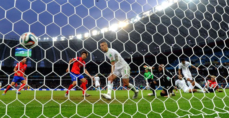 Koo Ja Cheol (2nd L) of Korea Republic shoots a goal during a Group H match between Korea Republic and Algeria of 2014 FIFA World Cup at the Estadio Beira-Rio .