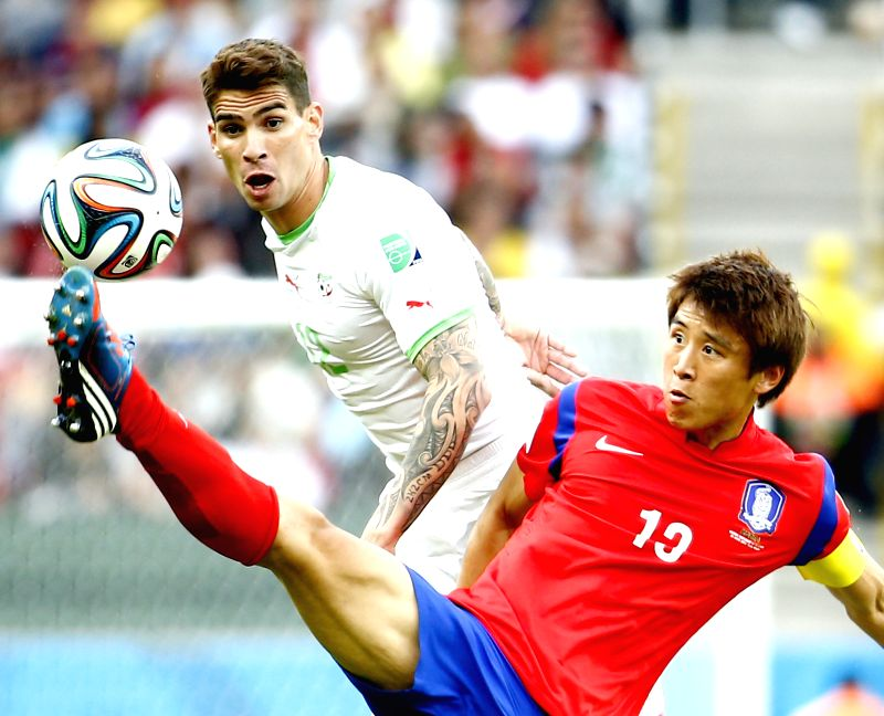 Korea Republic's Park Chu Young vies for the ball with Algeria's Carl Medjani during a Group H match between Korea Republic and Algeria of 2014 FIFA World Cup .