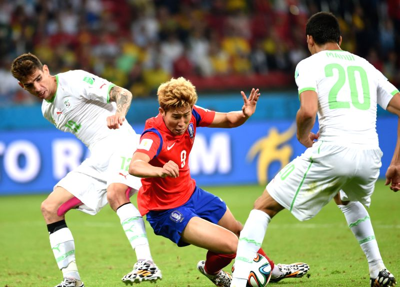 Son Heung Min (L) of Korea Republic vies with Carl Medjani of Algeria during a Group H match between Korea Republic and Algeria of 2014 FIFA World Cup at the ..