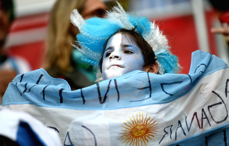 A young supporter of Argentina is seen before a Group F match between Nigeria and Argentina of 2014 FIFA World Cup at the Estadio Beira-Rio Stadium in Porto ...