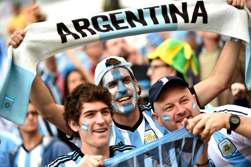 Argentina's supporters cheer before a Group F match between Nigeria and Argentina of 2014 FIFA World Cup at the Estadio Beira-Rio Stadium in Porto Alegre, ...