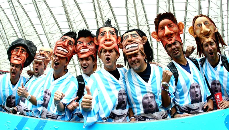 Argentina's supporters pose before a Group F match between Nigeria and Argentina of 2014 FIFA World Cup at the Estadio Beira-Rio Stadium in Porto Alegre, ...