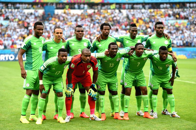 Nigeria's players pose for a group photo before a Group F match between Nigeria and Argentina of 2014 FIFA World Cup at the Estadio Beira-Rio Stadium in Porto .