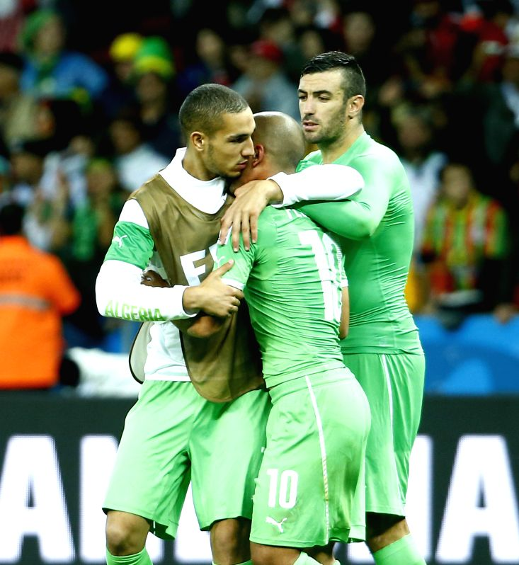 Algeria's players react after a Round of 16 match between Germany and Algeria of 2014 FIFA World Cup at the Estadio Beira-Rio Stadium in Porto Alegre, Brazil, .