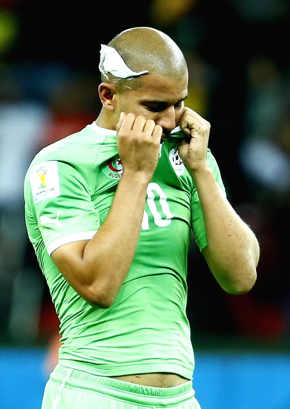 Algeria's Sofiane Feghouli reacts after a Round of 16 match between Germany and Algeria of 2014 FIFA World Cup at the Estadio Beira-Rio Stadium in Porto ...
