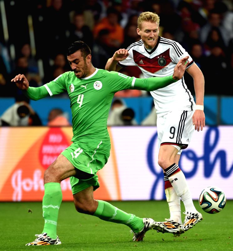 Algeria's Essaid Belkalem (L) vies with Germany's Andre Schurrle during a Round of 16 match between Germany and Algeria of 2014 FIFA World Cup at the Estadio ..