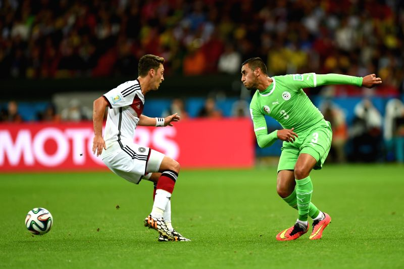 Algeria's Faouzi Ghoualm (R) vies with Germany's Mesut Ozil during a Round of 16 match between Germany and Algeria of 2014 FIFA World Cup at the Estadio ...
