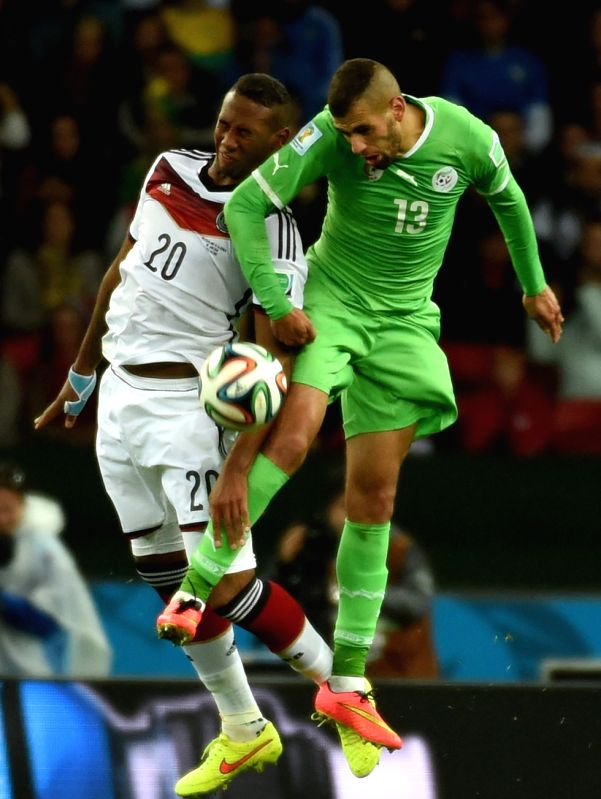 Algeria's Islam Slimani (R) vies with Germany's Jerome Boateng during a Round of 16 match between Germany and Algeria of 2014 FIFA World Cup at the Estadio ...