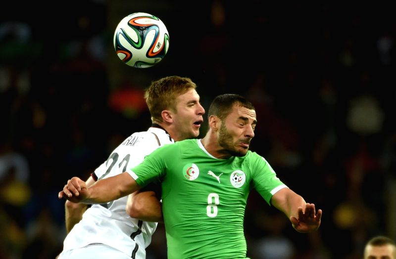 Algeria's Medhi Lacen (R) vies with Germany's Christoph Kramer during a Round of 16 match between Germany and Algeria of 2014 FIFA World Cup at the Estadio ...