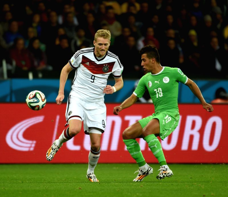 Algeria's Saphir Taider (R) vies with Germany's Andre Schurrle during a Round of 16 match between Germany and Algeria of 2014 FIFA World Cup at the Estadio ...