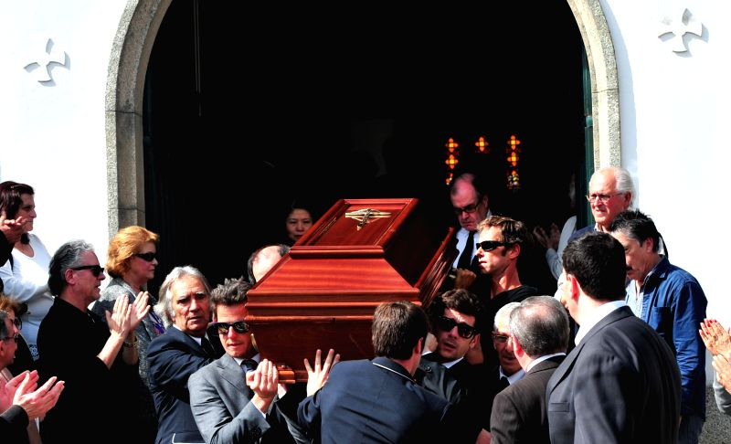 Pallbearers carry the coffin of Portuguese filmmaker Manoel de Oliveira during a funeral in Porto, Portugal, on April 3, 2015. Portuguese filmmaker Manoel de Oliveira ...