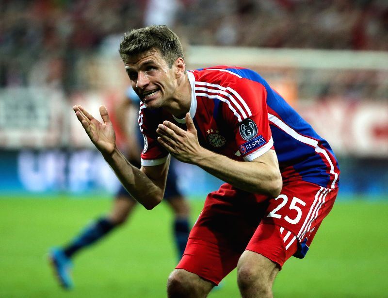 Bayern Munich's Thomas Muelle reacts during their UEFA Champions League quarterfinal match against FC Porto in Munich, Germany, on April. 21, 2015. Bayern Munich ...