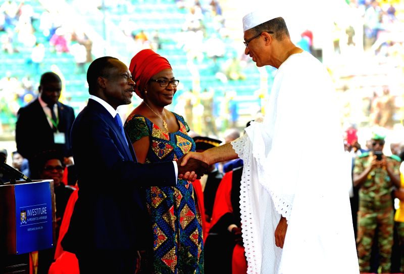 PORTO-NOVO, April 7, 2016  Benin's president Patrice Talon (L) shakes hands with the Prime Minister Lionel Zinsou during the swearing-in ceremony in Porto-Novo, the political capital of ... - Lionel Zinsou