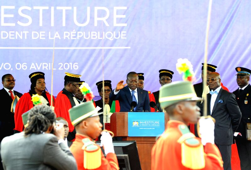 PORTO-NOVO, April 7, 2016  Benin's president Patrice Talon (C) swears during the swearing-in ceremony in Porto-Novo, the political capital of Benin, Apirl 6, 2016. The newly elected President ...