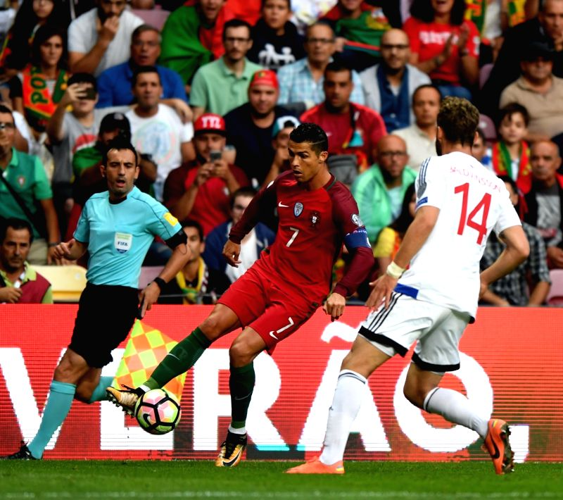 PORTO, Sept. 1, 2017 - Cristiano Ronaldo of Portugal (C) competes during the FIFA World Cup 2018 Qualifiers Group B match between Portugal and Faroe Islands at Bessa stadium in Porto, Portugal, on ...