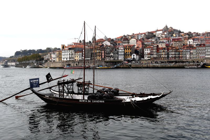 PORTO, Sept. 30, 2017 - Photo taken on Sept. 29, 2017 shows a barge on the Douro River in Porto, Portugal. Porto is the second largest city of Portugal.