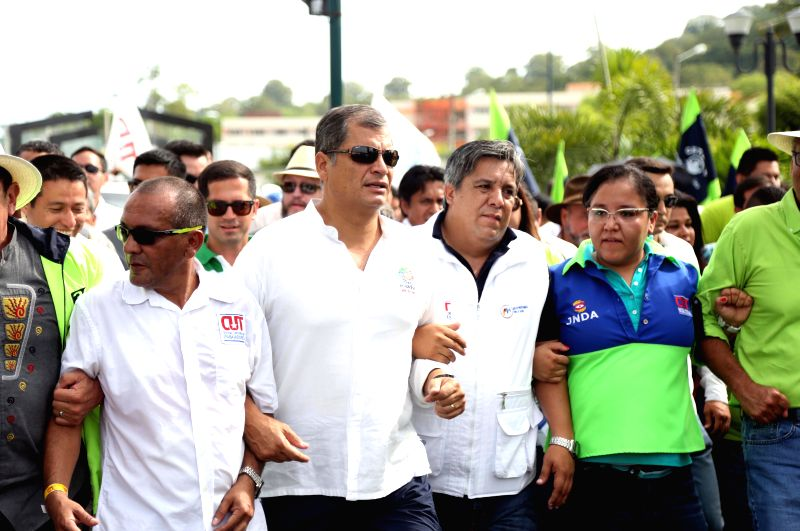 PORTOVIEJO, May 2, 2017 - Ecuadorian President Rafael Correa (2nd L) takes part in a parade marking the International Workers' Day in Portoviejo, Ecuador, on May 1, 2017. /IANS)