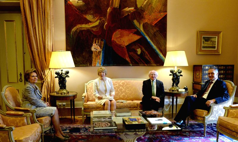 Portuguese President Anibal Cavaco Silva (R), his wife Maria (L), Ireland's President Michael Higgins (2nd R), and his wife Sabina (2nd L) meet at Belem Palace in ...