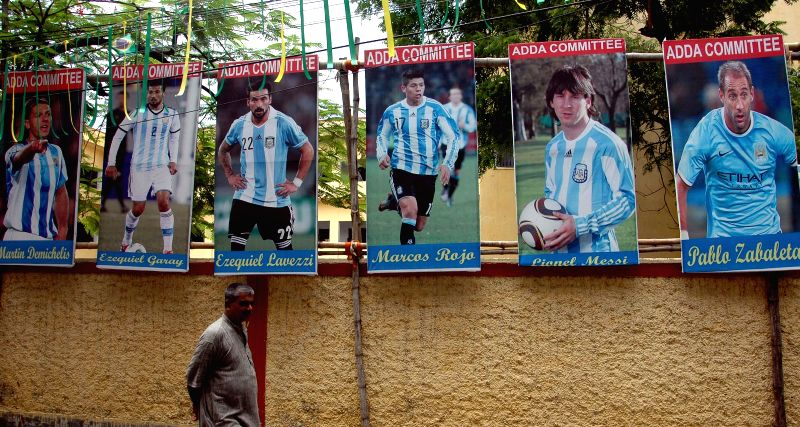 Posters of Argentine footballers put-up by supporters of Argentine football team in Kolkata on July 1, 2014.