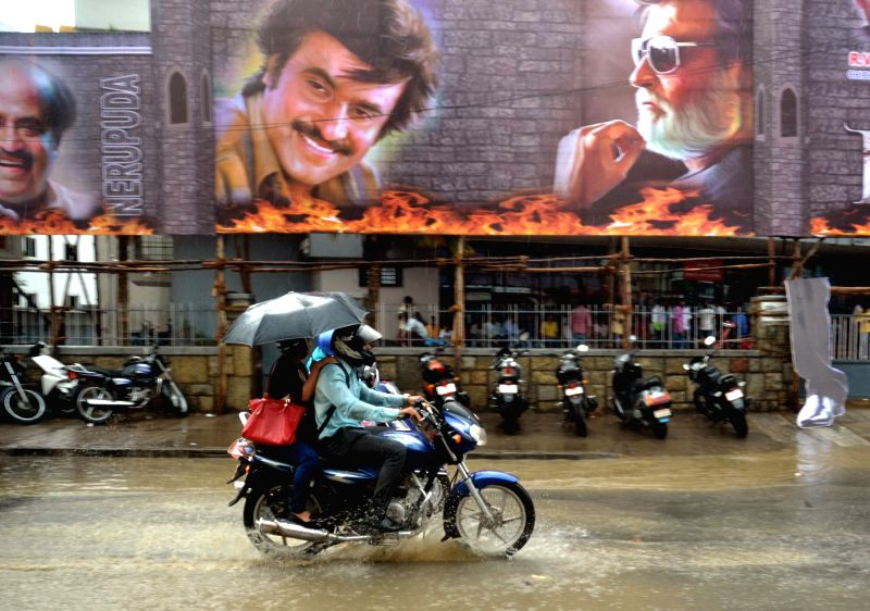 "Posters of Rajinikanth's upcoming Tamil Film ""Kabali"" being erected at Urvashi theatre ahead of its release in Bengaluru on July 20, 2016."