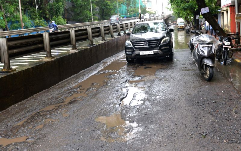 Potholes appear in Mumbai roads after heavy rains lashed the city over past few days on July 11, 2018.