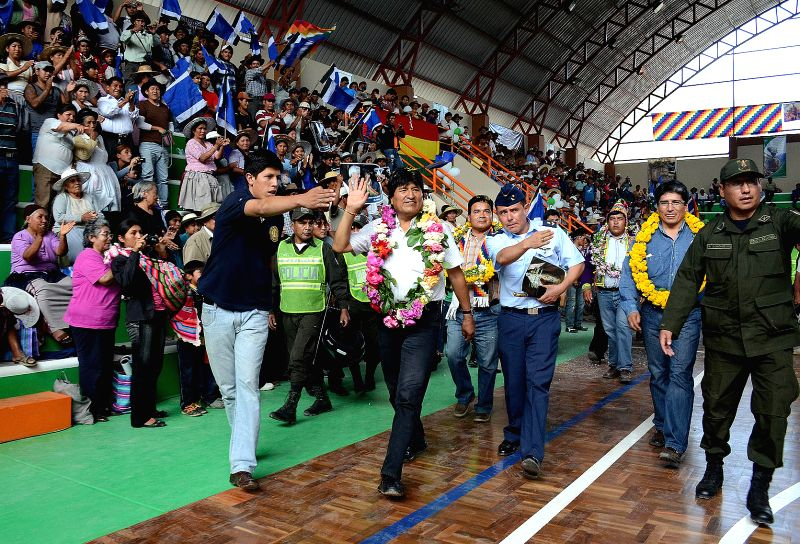 Bolivia's President Evo Morales (2nd L, front) attends the delivery ceremony of a coliseum in the Torotoro municipality, Potosi department, Bolivia, on Dec. 20, ...