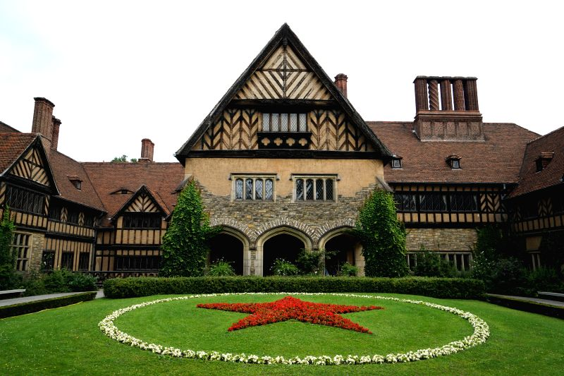 Photo taken on July 26, 2014 shows the Cecilienhof Palace in Potsdam, capital of Germany's Brandenburg state, where the Potsdam Proclamation was issued in 1945.  ...