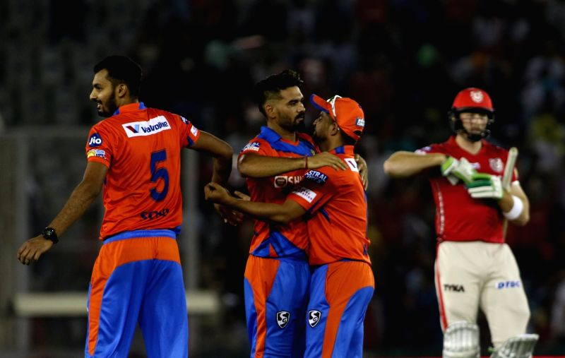 Pradeep Sangwan of Gujarat Lions celebrates fall of Martin Guptill's wicket during an IPL 2017 match between Kings XI Punjab and Gujarat Lions at Punjab Cricket Association IS Bindra Stadium ...