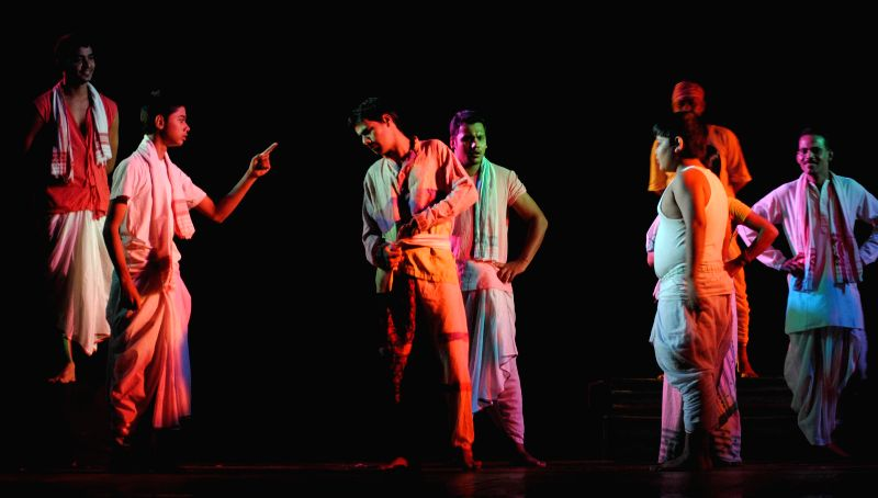 Pranab Kumar Barman's drama titled 'Bagh Bahadur' being staged by artist of Jonaki Kareng, Nalbari at Rabindra Bhawan in Guwahati on June 24, 2014. - Pranab Kumar Barma