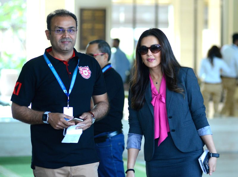 Preity Zinta and Virender Sehwag of Kings XI Punjab arrives to attend Indian Premier League (IPL) Players' Auction in Bengaluru on Jan 28, 2018. - Preity Zinta