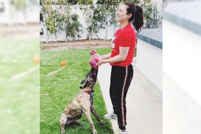 Preity Zinta workout with pet dog.