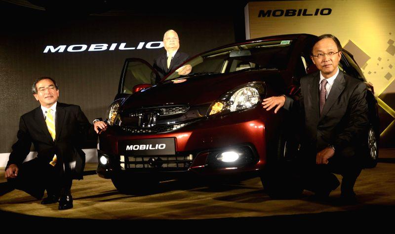 President & CEO, Honda Cars India Limited Hironiri Kanayama and Honda Motor Company Managing Officer Yoshiyuki Matsumoto during the launch of Honda Mobilio in Mumbai on July 24, 2014.