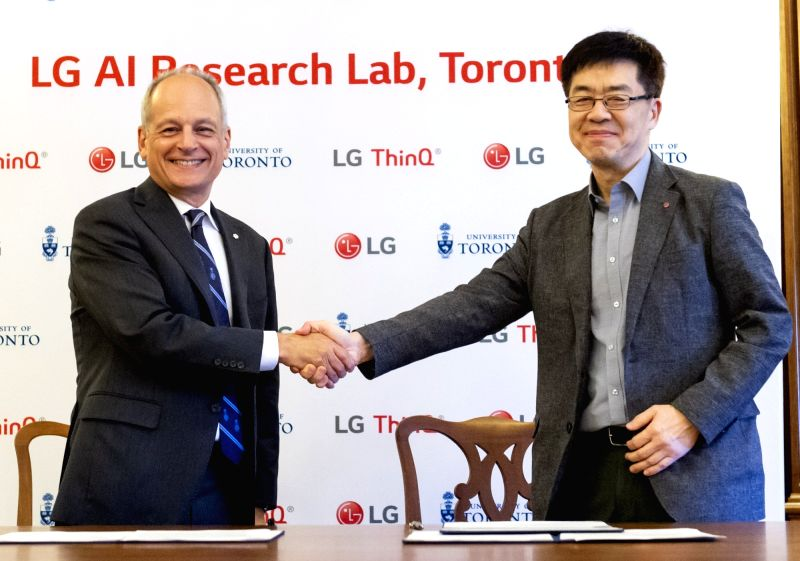 President Meric Gertler of the University of Toronto (L) shakes hands with LG Electronics Inc. Chief Technology Officer Park Il-pyung after reaching an agreement on joint artificial ...