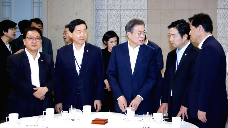 President Moon Jae-in (3rd from R) talks to Cabinet members ahead of a Cabinet meeting at Cheong Wa Dae in Seoul on July 24, 2018.