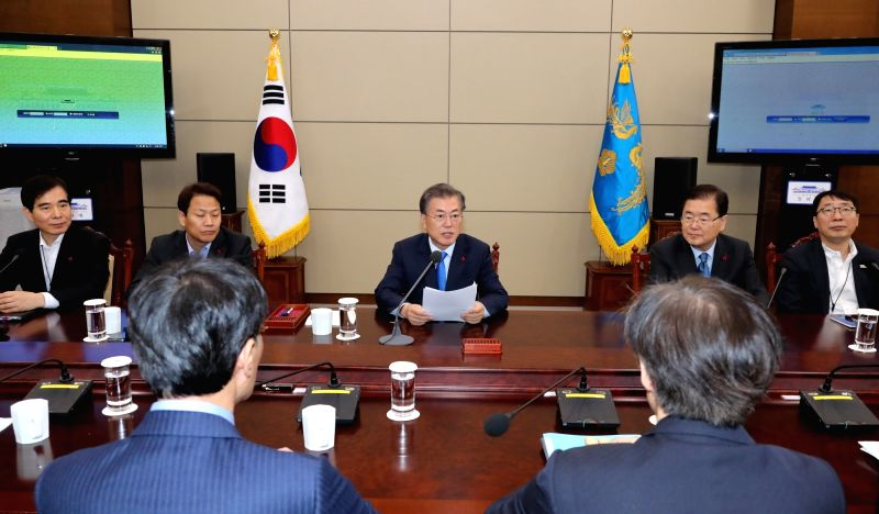 President Moon Jae-in (C, rear) speaks in a meeting with his senior secretaries at the presidential office Cheong Wa Dae in Seoul on Jan. 22, 2018.
