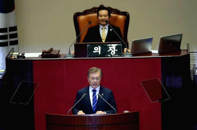 President Moon Jae-in calls for ruling and opposition parties to cooperate in drawing up an 11.2 trillion-won (US$9.9 billion) extra budget to create jobs for the youth in Seoul on June 12, 2017, ...