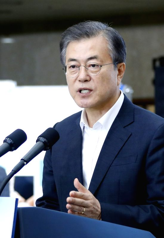 President Moon Jae-in speaks during a meeting with a group of patients and their families at a hospital in Seongnam, just south of Seoul, on July 19, 2018. Moon called for stepped-up ...