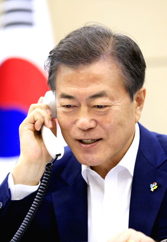 President Moon Jae-in speaks to U.S. President Donald Trump over the phone at Cheong Wa Dae in Seoul on June 11, 2018, in this photo provided by the presidential office. The telephone ...